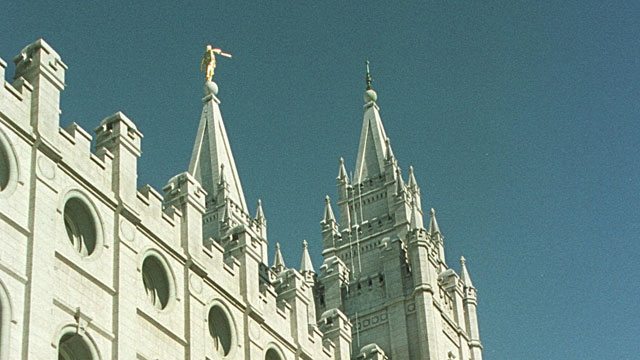 PHOTO: Morman Missionary Stacey Bernal conducts a tour at the Mormon Temple