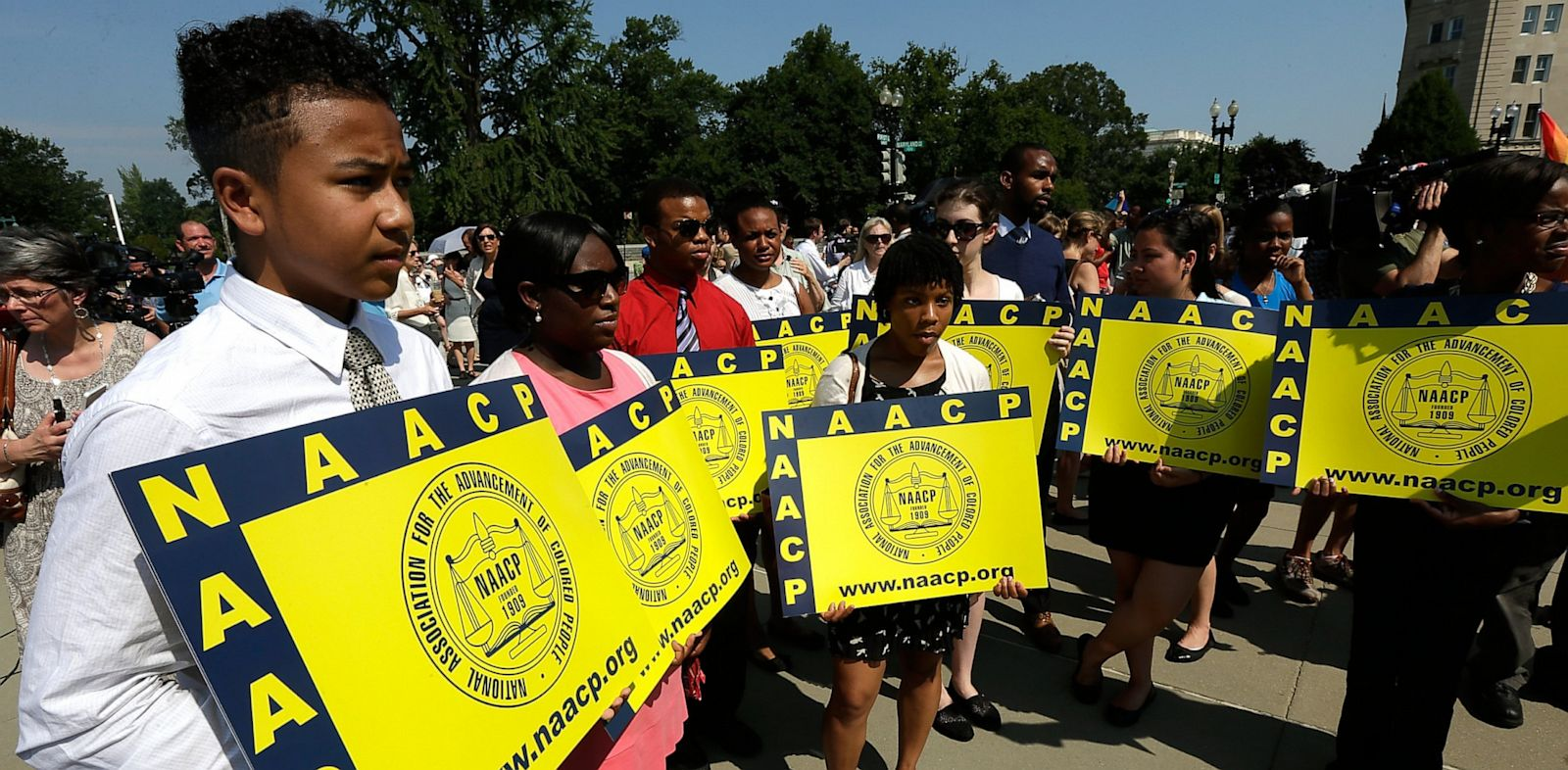 PHOTO: Supporters of the National Association for the Advancement of Colored People (NAACP) hold signs outside the U.S. Supreme Court building on June 25, 2013 in Washington, D.C.