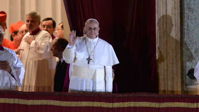 PHOTO: New Pope, Argentinian cardinal Jorge Mario Bergoglio appears at the window of St Peters Basilicas balcony after being elected the 266th pope of the Roman Catholic Church.