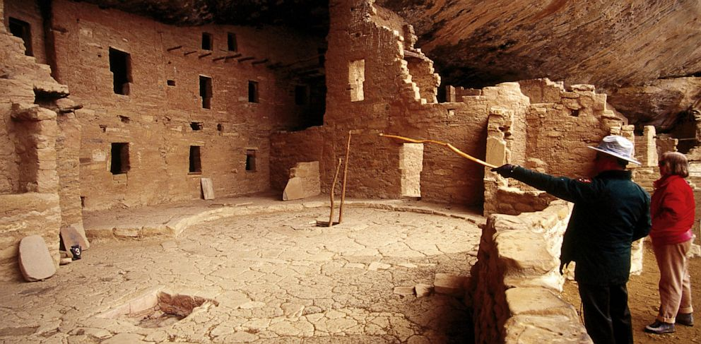 PHOTO: Tourists look at Spruce Tree House in Mesa Verde National Park in Colorado.