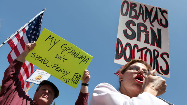 PHOTO: Protestors hold signs during an anti-health care reform rally August 14, 2009 in San Francisco, California.