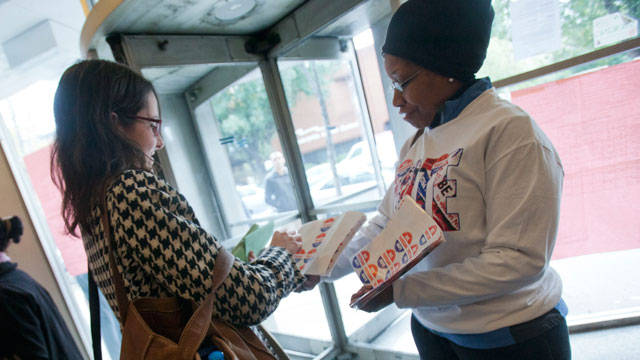 PHOTO: Sharan Rahman (R) hands out I Voted Today! stickers to voters at a downtown health center on November 6, 2012 in Philadelphia, Pennsylvania.