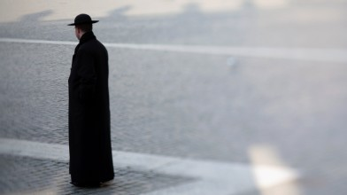 PHOTO:A priest walks through St. Peter's Square in Vatican City.
