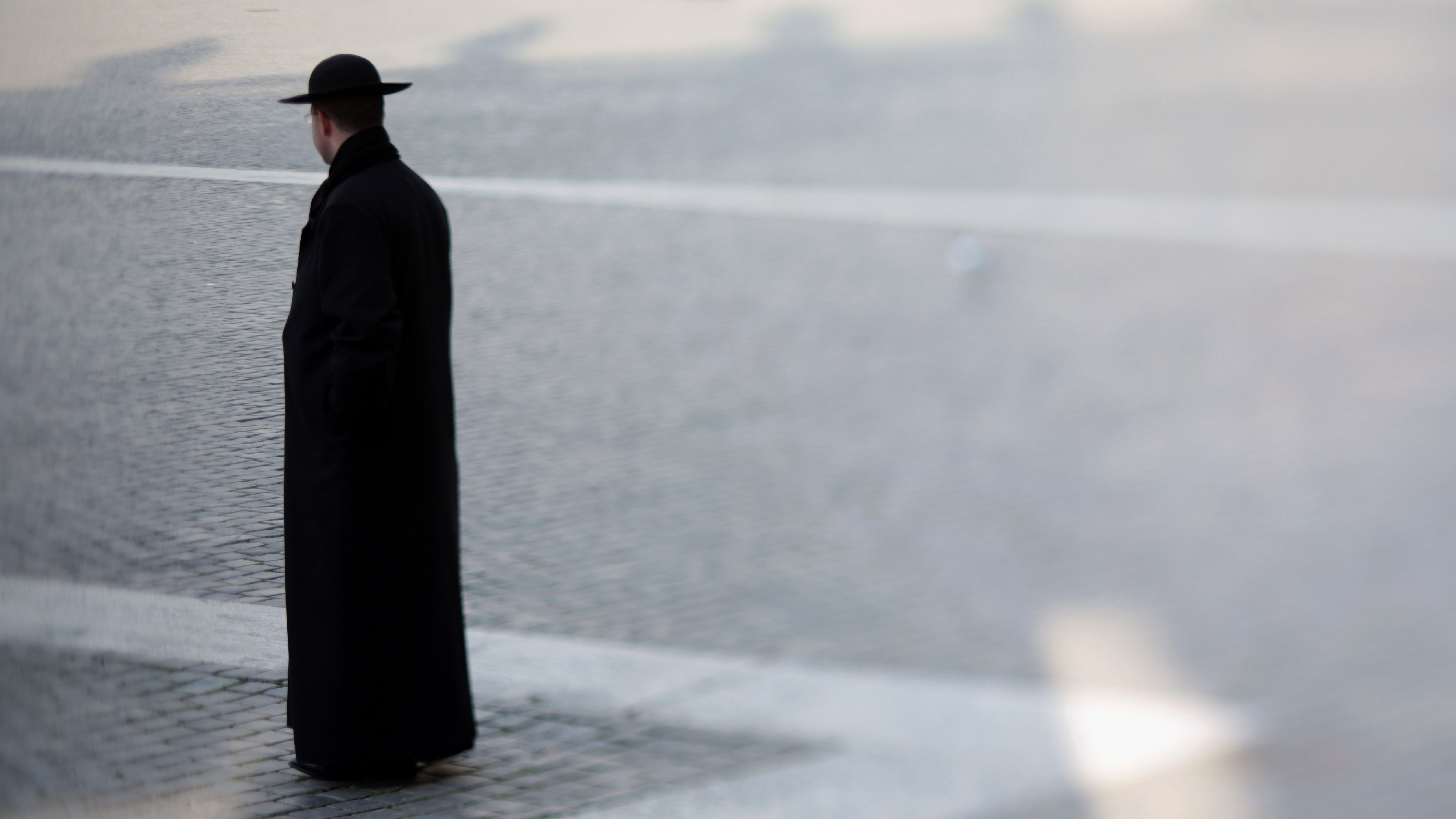 PHOTO: A priest walks through St. Peter's Square in Vatican City.