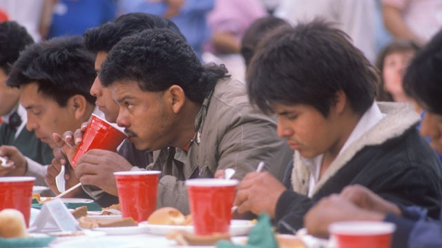 PHOTO: Latino men eat Christmas dinner at a homeless shelter in Los Angeles, California.
