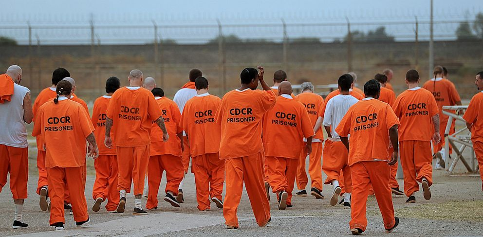 PHOTO: Prisoners walk a lap in a recreation yard at Deuel Vocational Institution in Tracy, California.