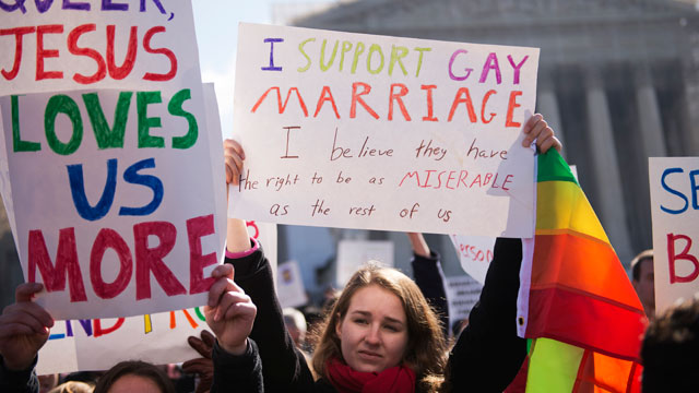 PHOTO: Amanda Smart of Georgetown University, holds a sign supporting gay marriage outside of the Supreme Court during opening arguments on the opposition to Californias Proposition 8 that bans gay marriage.