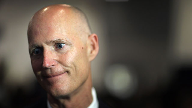 PHOTO: Florida Governor Rick Scott speaks to the media after signing Florida Senate Bill 52, legislation to ban texting while driving on May 28, 2013 in Miami, Florida.