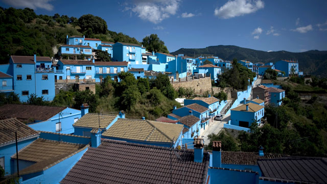 PHOTO: Smurf Blue. The village of Juzcar, Spain, had its homes painted blue, for a smurf movie premier in 2011. Tourists flooded the village, which now wants to stay blue, forever.