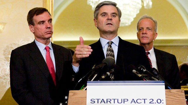 PHOTO: Steve Case, a member of President Obama's Council on Jobs and Competitiveness, speaks as Senators Jerry Moran (R-KS) and Mark Warner (D-VA) look on, at the Capitol in Washington, D.C., on Tuesday, May 22, 2012.