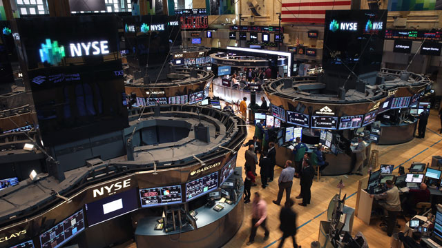PHOTO: Traders work the floor of the New York Stock Exchange after the opening bell on June 20, 2013 in New York City.