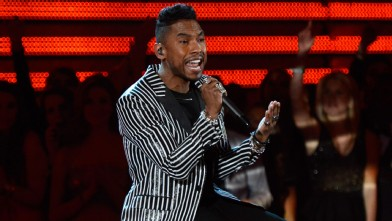 PHOTO:Miguel's jacket is both weird and totally working for him.