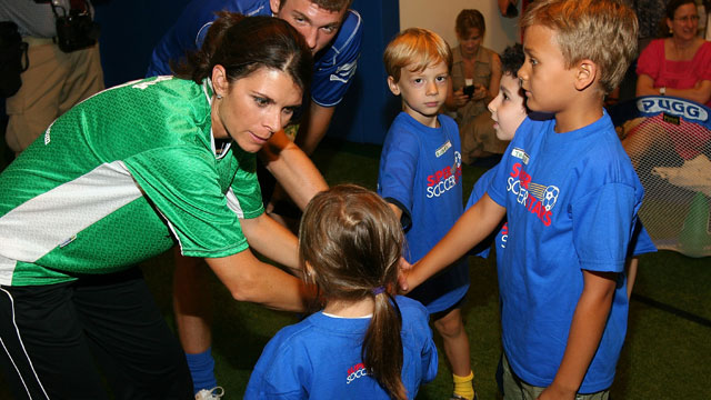 PHOTO: Soccer Player Mia Hamm teaches children about soccer and flu vaccinations at Super Soccer Stars Indoor Soccer Field on August 20, 2009 in New York City.