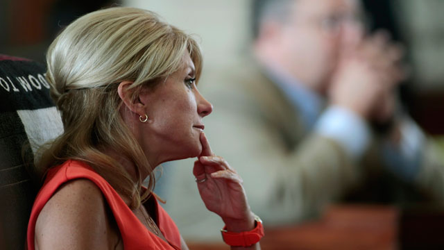 PHOTO:Texas Sen. Wendy Davis (D-Ft. Worth) sits at her desk on the Texas Senate floor during a legislative special session called by Gov. Rick Perry on July 1, 2013 in Austin, Texas.