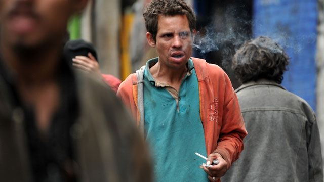 PHOTO: A man smokes bazuco (cocaine base) in an outlying area in downtown Bogota known as Calle del Bronx.