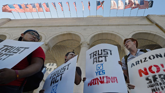 PHOTO:File - Activists and community leaders attend a rally and a news conference in support of the TRUST Act.