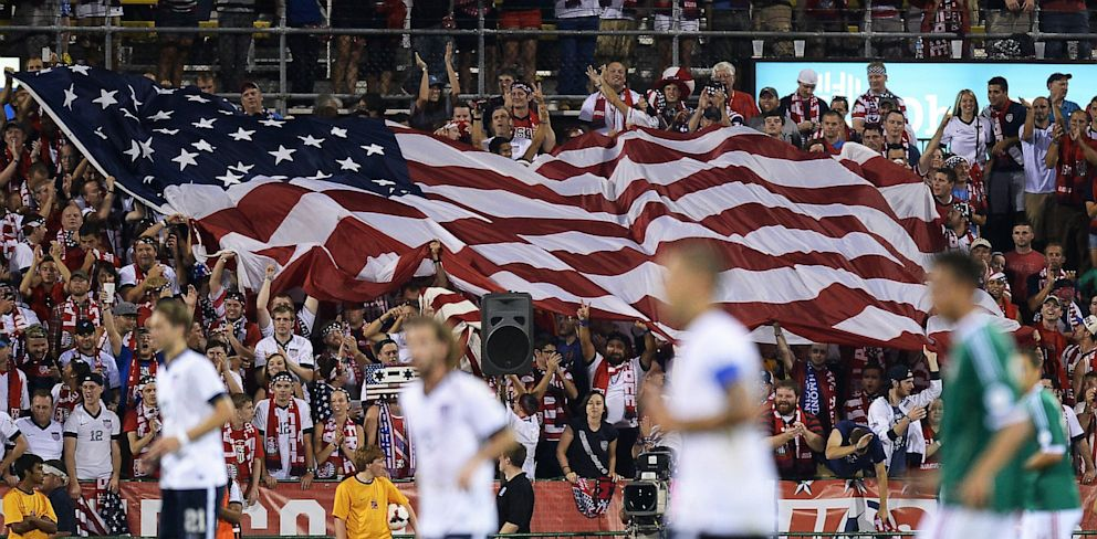 PHOTO: Fans unfurl a large U.S. flag after the U.S. Mens National Team scored their second goal against Mexico.