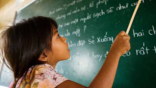 PHOTO: An ethnic Khmer schoolgirl practices reading at Lac Hoa Primary School, Dai Bai commune.