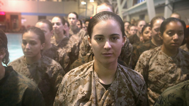 PHOTO: Female Marine recruits prepare for a swimming test during boot camp February 25, 2013 at MCRD Parris Island, South Carolina. Male and female recruits are expected to meet the same standards during their swim qualification test.