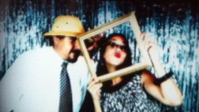 PHOTO: Mamita Mala and her boyfriend do the photo booth at a friends wedding. But will he put a ring on it?