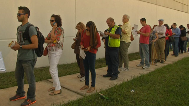 Long lines like at this Miami polling place, have turned some early voters away.