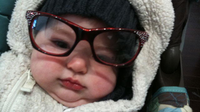 PHOTO: A baby wearing hipster glasses.