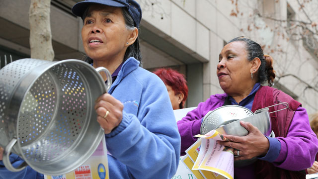 PHOTO: Domestic workers Amelia Barnachea (left) and Rosa Sanchez bang pots outside the State Building in downtown Los Angeles in support of AB 241 on March 7, 2013.