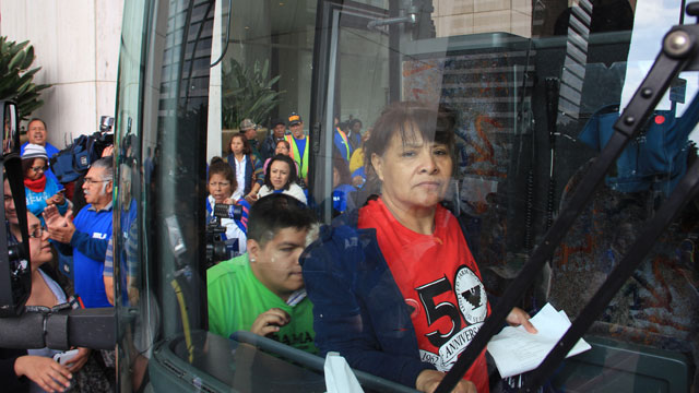 PHOTO: Martha Carrillo (right) and Angel Barrera board a bus touring Southern California to promote comprehensive immigration reform.