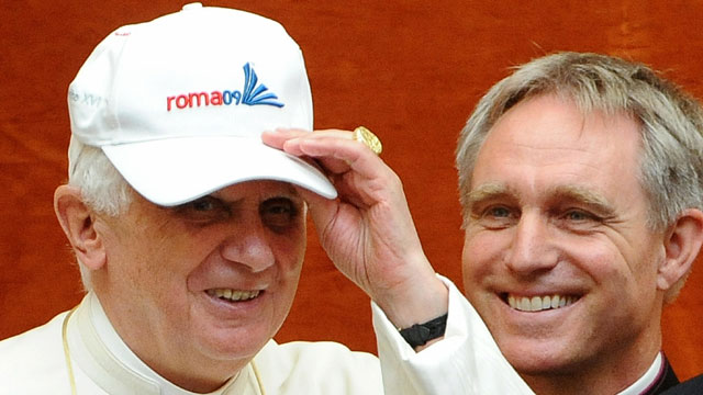 PHOTO:Pope Benedict XVI wears a cap offered by Germany's Paul Biedermann, gold medallist in the men's 200m freestyle.
