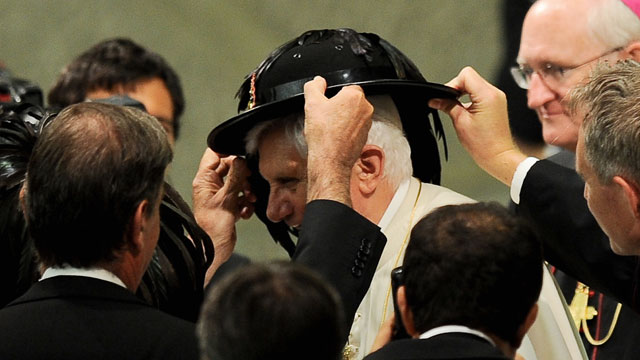 PHOTO: Pope Benedict XVI receives a hat as a gift from Italian Bersaglieri soldiers in Aula Paolo VI at the Vatican during his weekly general audience on September 15, 2010