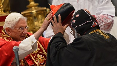PHOTO:India's Baselios Cleemis Thottunkal receives his hat as Pope Benedict XVI (L) appoints him as a cardinal during a ceremony on November 24, 2012 at St Peter's basilica at the Vatican.
