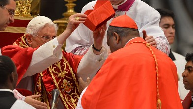 PHOTO: Nigeria's John Onaiyekan receives his biretta hat as Pope Benedict XVI (L) appoints him as a cardinal during a ceremony on November 24, 2012 at St Peter's basilica at the Vatican.