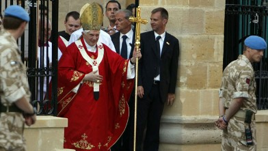 PHOTO: Pope Benedict XVI leaves Nicosia's Latin Church of the Holy Cross in the divided capital of Cyprus after celebrating mass on June 5, 2010
