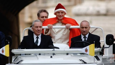PHOTO: Pope Benedict XVI arrives in St. Peter's Square for his weekly audience on December 28, 2005 in Vatican City. The Pontif dressed for the second time in the red hat used by Pope John XXIII forty years ago.