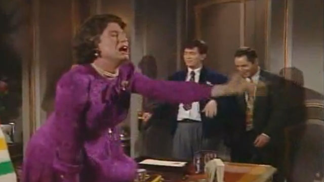 "PHOTO: Screenshot from a ""Kids In The Hall"" episode with a spoof cameo by Queen Eliabeth II."