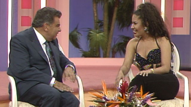 """Sabado Gigante's"" host Don Francisco sits with slain singer Selena during her appearance on the show in 1995."