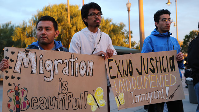 PHOTO:Jose Mondragon (left) Jesus Daniel Mendez Carbajal and Manuel Enriquez hold signs in support of undocumented immigrants at a coming out rally in Los Angeles.
