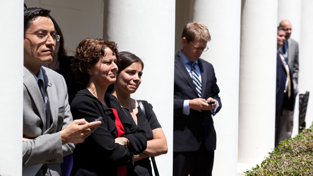 PHOTO: Luis Miranda, then director of Hispanic media (left), stands with other White House staff members as President Barack Obama delivers remarks on the Department of Homeland Security?s immigration announcement in the Rose Garden, June 15, 2012.