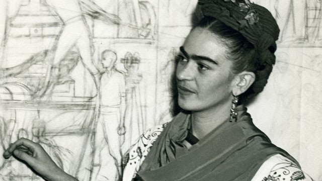 Frida Kahlo in front of a sketch of the Pan-American Unity mural's central panel at the San Francisco City College Auditorium, 1940.