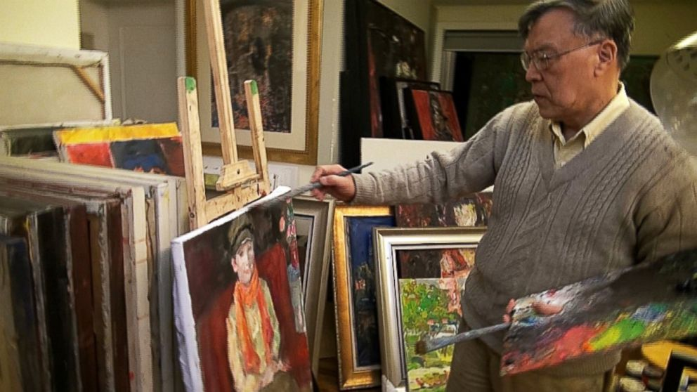 PHOTO: Artist Pei Shen Qian paints in his studio in China. Qian has been indicted in the U.S. for his alleged role in an art fraud scheme, but he claims he never knew his works would be sold as originals by other famous artists.