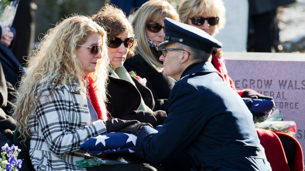 PHOTO: Maj. Gen. Steven Lepper, front right, consoles the family of U.S. Air Force Col. Francis McGouldrick Jr., from left, Marri Petrucci, Melisa Hill, Megan Genheimer, Michele Guess.