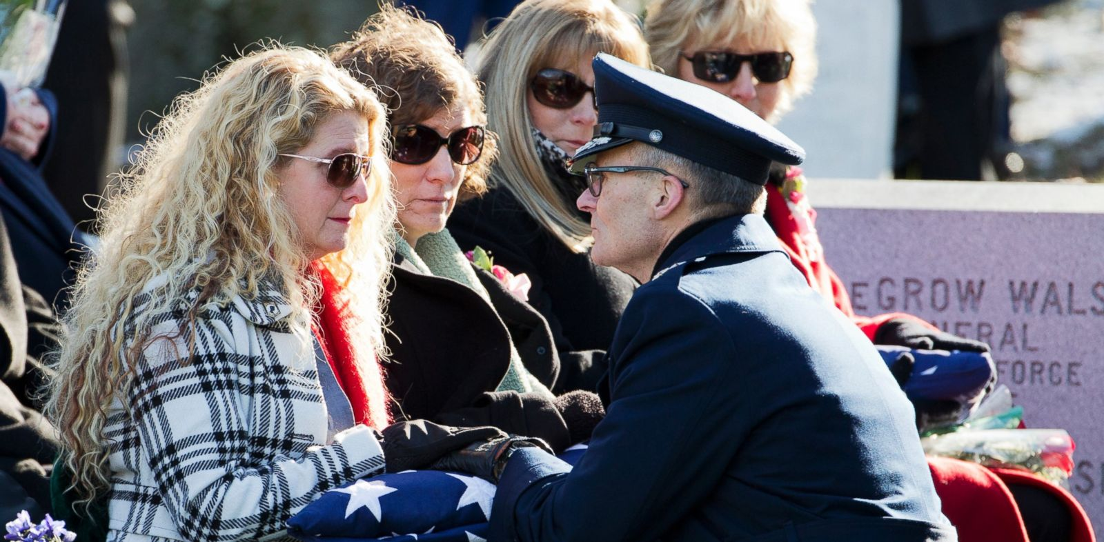 PHOTO: Maj. Gen. Steven Lepper, front right, consoles the family of U.S. Air Force Col. Francis McGouldrick Jr., from left, Marri Petrucci, Melisa Hill, Megan Genheimer, Michele Guess.