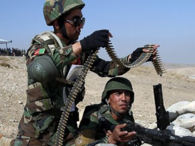 PHOTO: Afghan National Army soldiers load their belt-fed machine gun during a mock attack on an enemys stronghold during a military training exercise at Kabul Military Training Center, in Kabul, Afghanistan, Oct. 22, 2014.