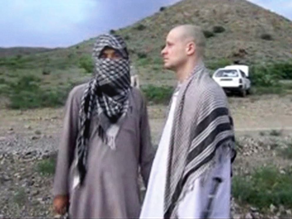 PHOTO: Sgt. Bowe Bergdahl, right, stands with a Taliban fighter in eastern Afghanistan, in this image taken from video obtained from Voice Of Jihad Website, which has been authenticated based on its contents and other AP reporting.