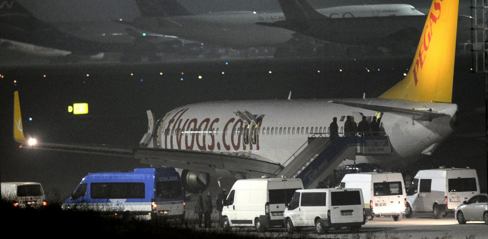 PHOTO: Turkish security officials enter the private Turkish company Pegasus plane before they evacuate passengers at the Sabiha Gokcen Airport in Istanbul, Turkey, Feb. 7, 2014.