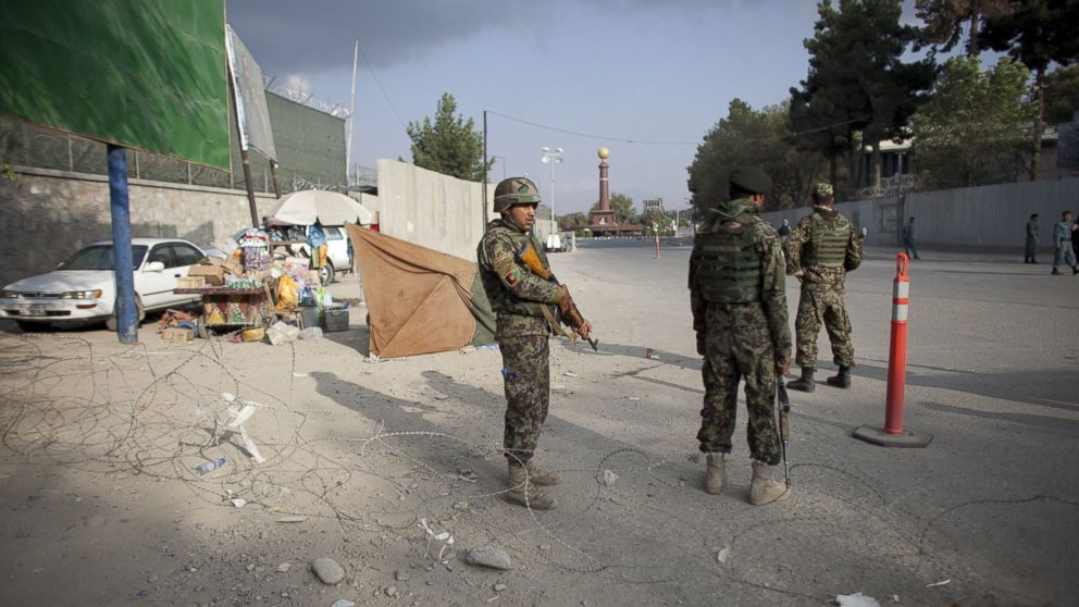 PHOTO: Afghan soldiers during an insurgent attack on the US Embassy near Massood Square, Sept. 13, 2011, in K
