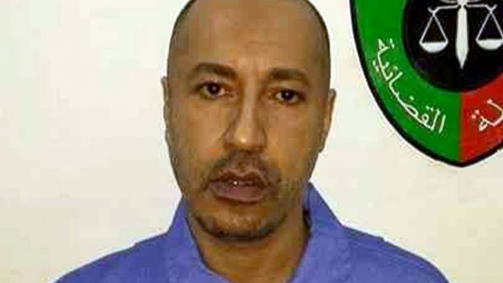 PHOTO: Saadi Gaddafi, son of ousted leader Muammar Gaddafi, is extradited from Niger and is transfered to prison in Tripoli, Libya, March 6, 2014.