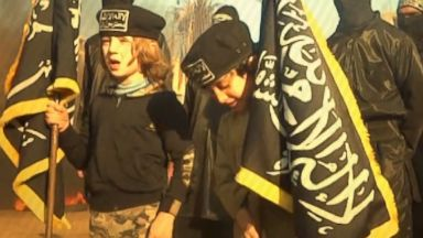 PHOTO: Two children used as flag bearers at an al Qaeda-linked militant training camp in Syria.