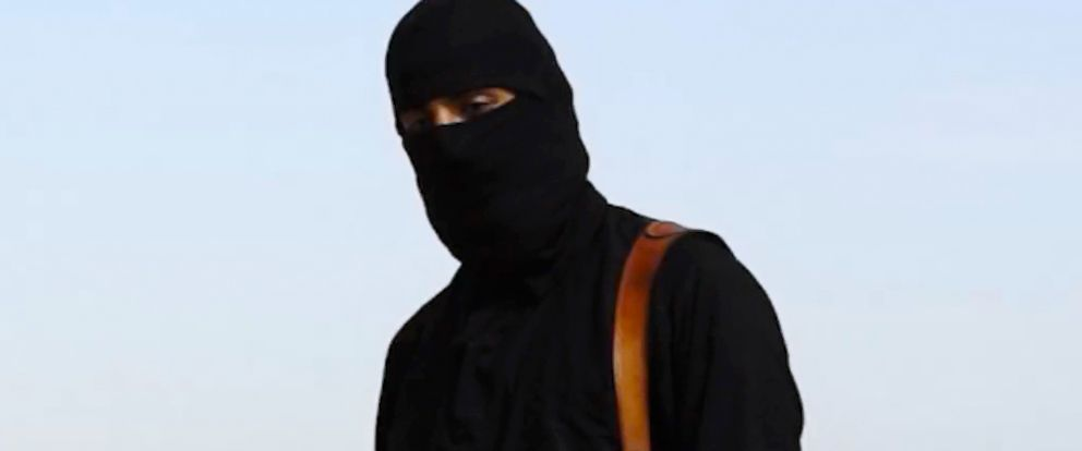 PHOTO: A masked man, who describes himself as a member of ISIS, appears to behead Western hostages in online videos.