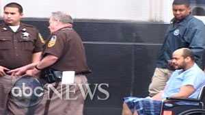 Andrew Warren is wheeled out of federal court in Norfolk, Virginia on Tuesday, April 27, 2010.